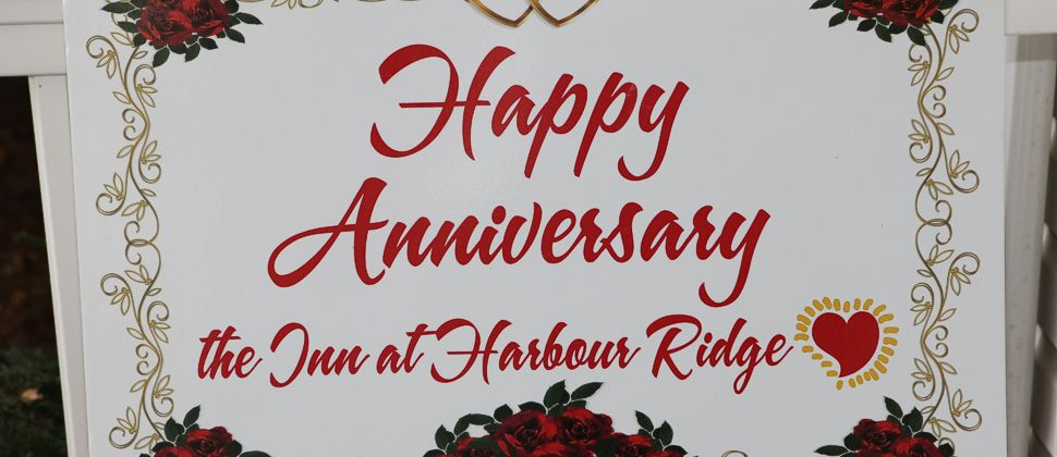 Large sign with the words Happy Anniversary the Inn at Harbour Ridge